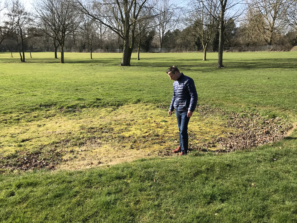 Anders inspects a green side bunker