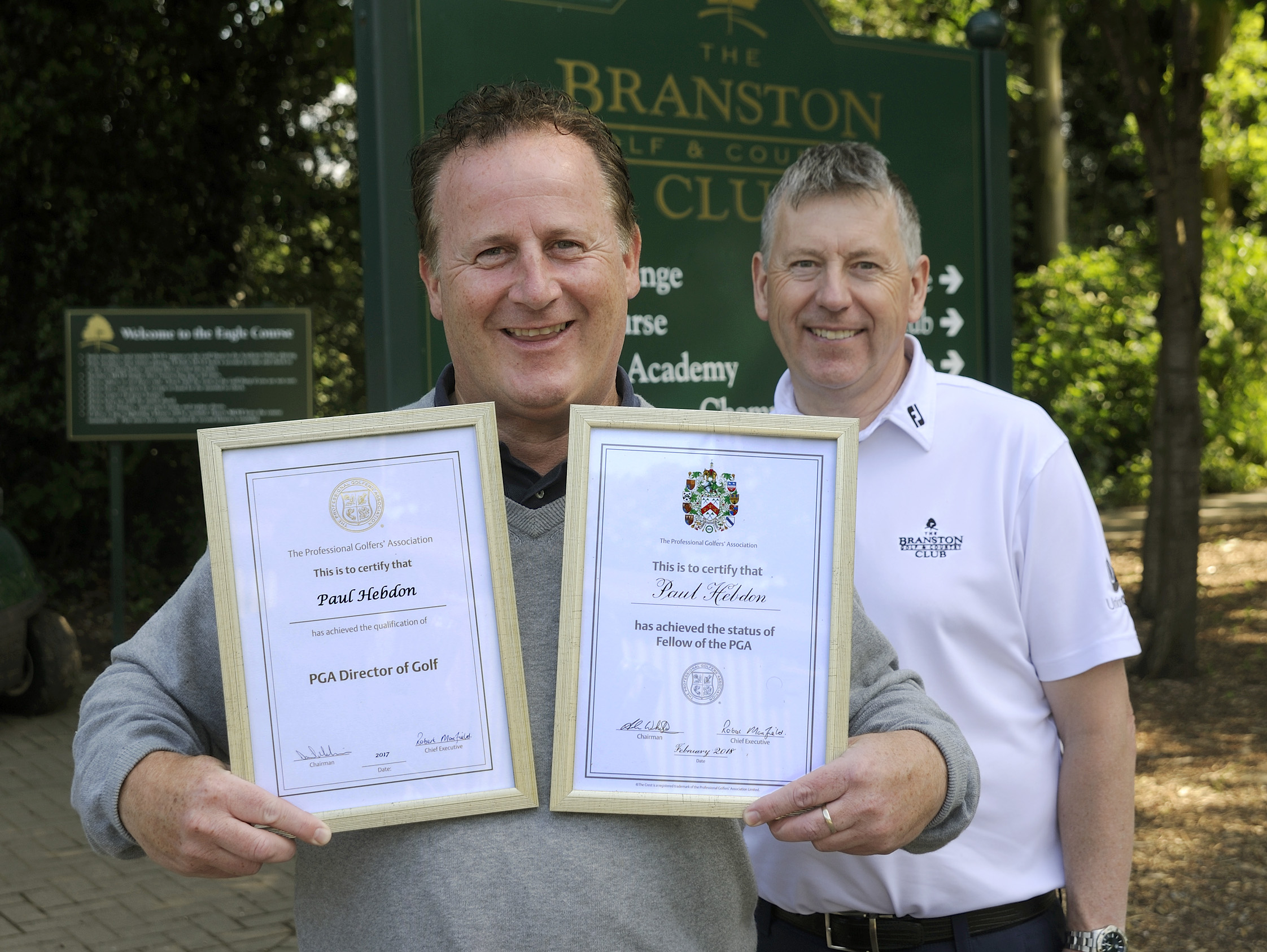 Paul Hebdon from Branston Golf & Country Club's Golf Academy proudly holding his PGA new membership certificates.